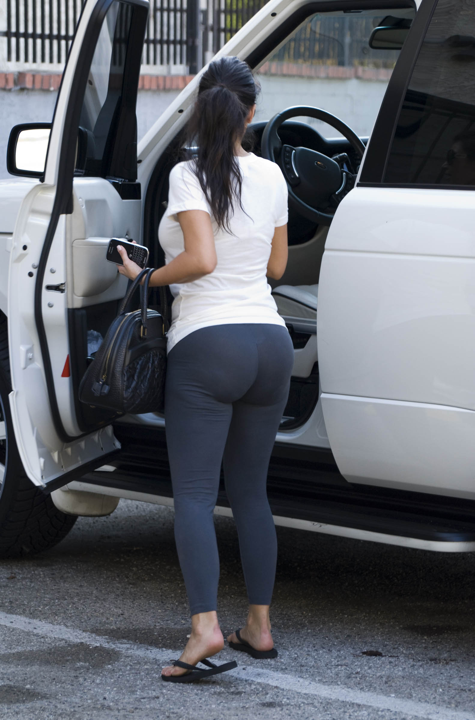 kim-kardashian-thong-in-black-leggings-2